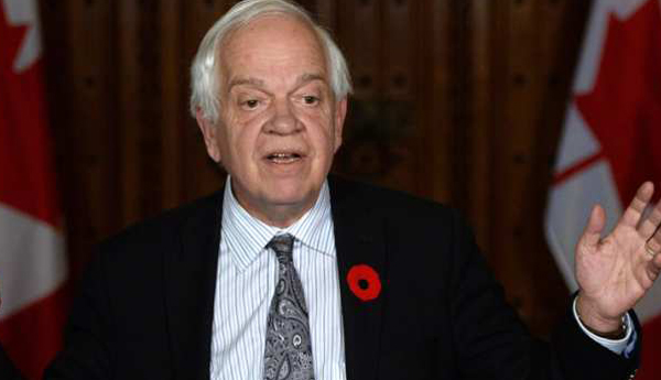 John McCallum, Minister of Immigration, Refugees and Citizenship.
